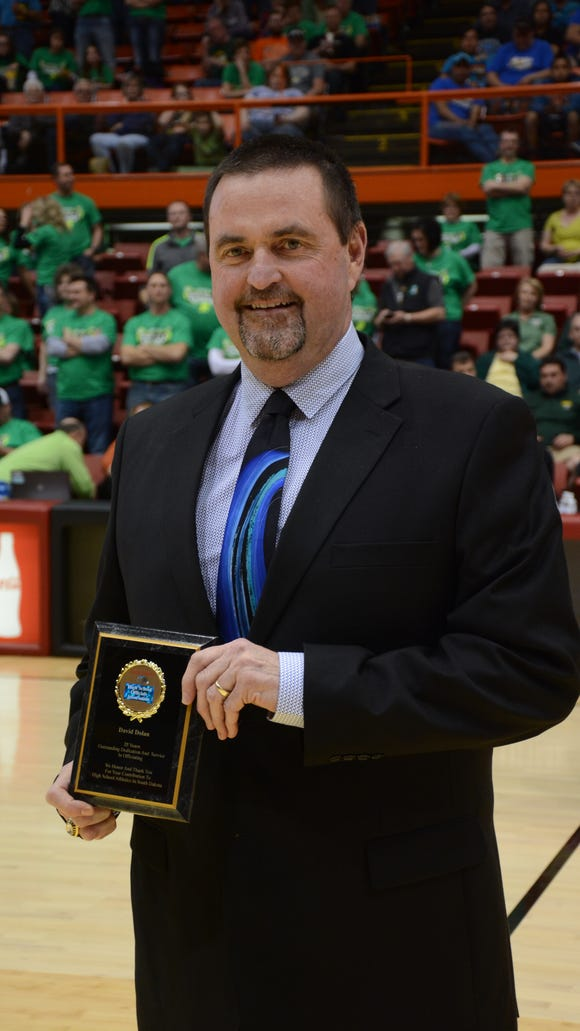 Rapid City Central's David Dolan was named the assistant boys coach of the year by the National High School Athletic Coaches Association.