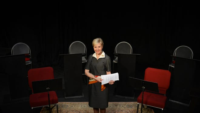 """Kellee Green Blake holds a copy of the script she wrote for the play """"Stronger Than Steel: Civil War Voices of Eastern Shore Women"""" at the main stage of the North Stree Playhouse in Onancock, Va. on Thursday, May 12, 2016. The play will be performed there soon."""