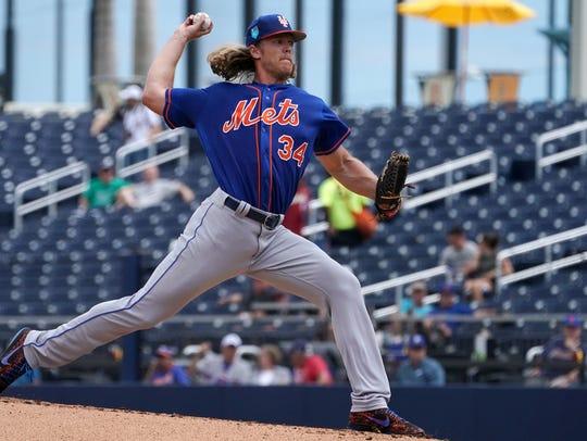 New York Mets pitcher Noah Syndergaard (34) delivers