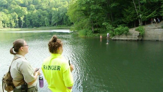 Ithaca Gorge Ranger Angela Sims, right, points her body camera toward people illegally swimming at Second Dam. She and Ranger Brittany Lagaly confronted about 20 people at Second Dam during this incident.