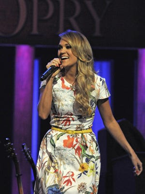 Carrie Underwood  performs at Grand Ole Opry  on Saturday May 10, 2014, in Nashville in Tenn.