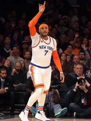 Knicks small forward Carmelo Anthony (7) reacts after a basket against the Charlotte Hornets during the first quarter at Madison Square Garden on Friday, Jan. 27, 2017. Knicks president Phil Jackson seems set on tearing down his latest rebuild, but he is playing a risky game of chicken with Anthony.