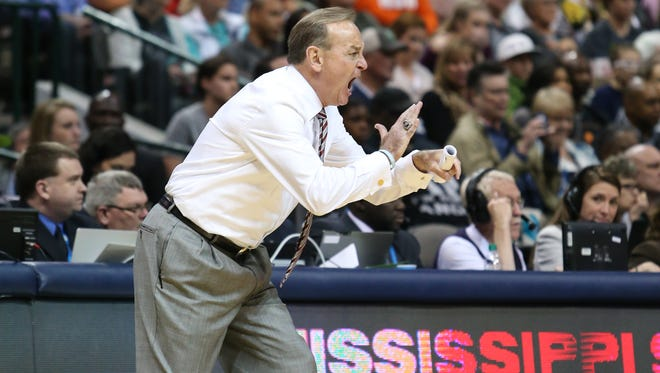 Mississippi State head basketball coach Vic Schaefer gives instructions to his team.