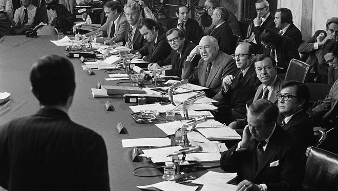 Members of the Senate Watergate Investigating Committee are seen during a hearing on Capitol Hill in Washington as they listen to witness Robert Odle (foreground) in this May 17, 1973, file photo.
