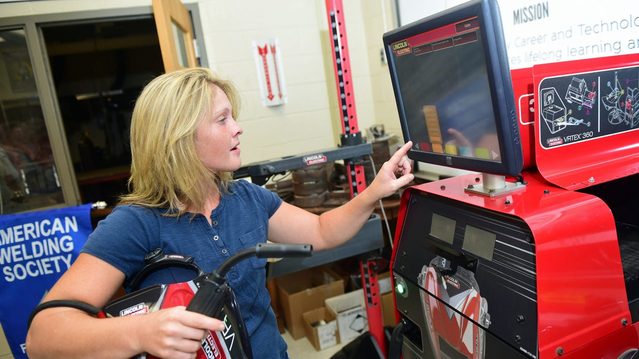 Manitowoc Crane donated a Virtual Welder to Franklin County Career and Technology Center. Instructor Elisa Ramsey gives a demonstration.