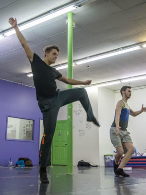 """Dancers Davis Wayne, left, and Nick Raynor rehearse for """"Pippin"""" at the Dance Factory in Coldwater. The show opens Thursday as part of Tibbits Summer Theatre."""