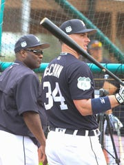 Tigers hitting coach Lloyd McClendon works with catcher
