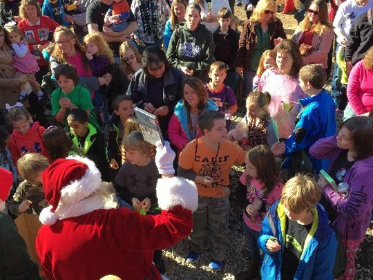 A crowd waits on O'Neal street in Belton for the Santa Express in December 2014.