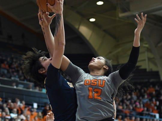 California forward Penina Davidson (12) and Oregon State forward Kolbie Orum (12) reach for a rebound during an NCAA college basketball game Sunday, Feb. 26, 2017, in Corvallis, Ore. (Anibal Ortiz/The Corvallis Gazette-Times via AP)
