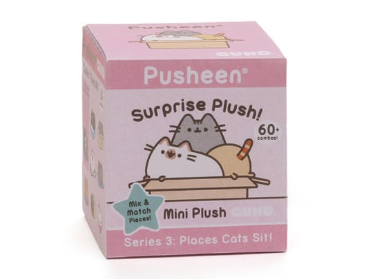 "This undated photo provided by Gund and Pusheen shows the Pusheen Surprise Plush Series 3 Blind Box: ""Places Cats Sit!"" The famous Facebook tabby cat Pusheen's popularity continues to grow, and she drew crowds at the Gund booth at February's Toy Fair in NYC. Gund has an exclusive series called ""Places Cats Sit!"", with Pusheen in various cat perches."