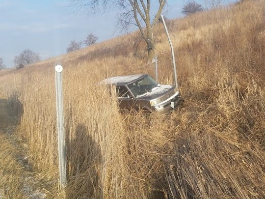 Nicky Bauerkemper's car, Boxy, sits forlorn in a ditch along Interstate 80 near Elk Horn on Dec. 22, 2017, shortly after the car slid off the icy road and knocked over a sign.