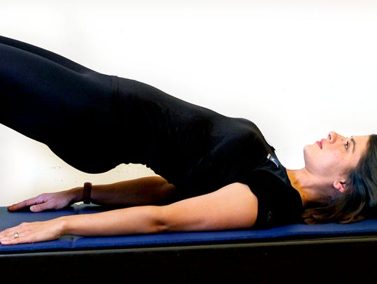 Erin Stern shows the ending position for the Pilates
