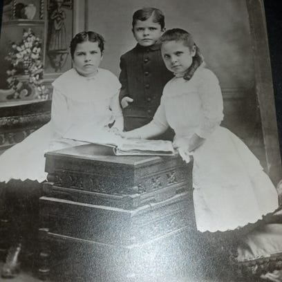 When Chris Church found this photo following the death of her parents, it started conversations among family members. The photo subjects were eventually identified as her grandfather and his two sisters.