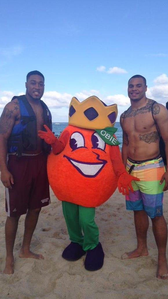 Benardrick McKinney and Dak Prescott enjoy a day at the beach in Miami during Orange Bowl festivities.