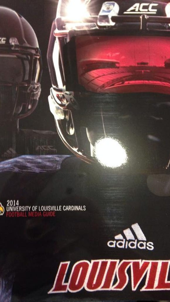 The Louisville football media guide for 2014 features all-black uniforms.