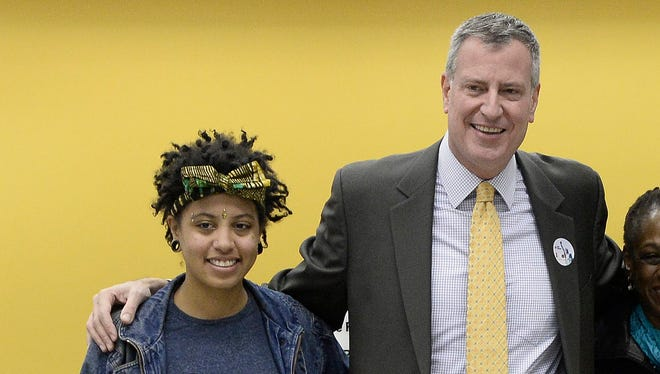New York Mayor-elect Bill de Blasio walks with his daughter Chiara after voting in the Brooklyn borough on Nov. 5, 2013.