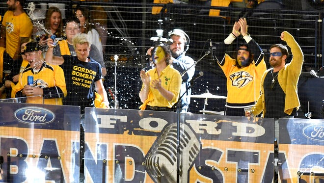 Kings of Leon get the crowd worked up as game four of the Western Conference finals begins at Bridgestone Arena Thursday, May 18, 2017 in Nashville, Tenn.