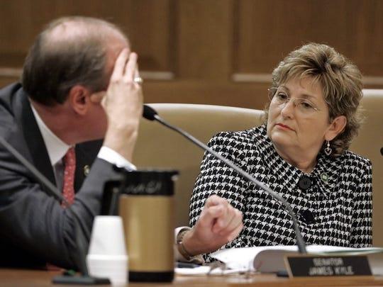 Sen. Diane Black, R-Gallatin, listens as Sen. Jim Kyle, D-Memphis, left, discusses a proposal sponsored by Black in the Senate Judiciary Committee Tuesday, Jan. 8, 2008 in Nashville, Tenn. (AP Photo/Mark Humphrey)