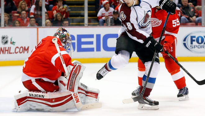 Colorado Avalanche center Daniel Briere (48) watches as Erik Johnson (6) scores against Detroit Red Wings goalie Petr Mrazek (34) during the third period of an NHL hockey game in Detroit, Sunday, Dec. 21, 2014.