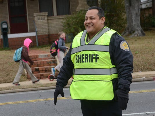 ANI Law Enforcement Officer Appreciation Day Rapides Sheriff's Deputy Horacio Cortez directs traffic on Main Street outside Pineville Elementary School Friday, Jan. 9, 2015. -Melinda Martinez/mmartinez@thetowntalk.com