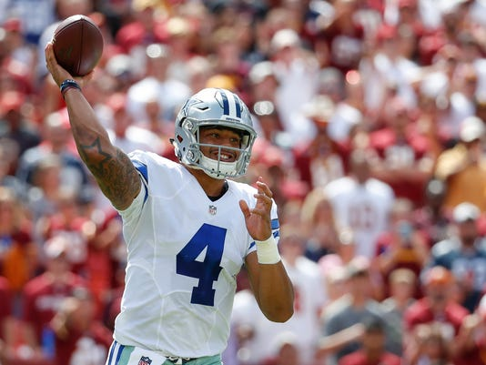 FILE - In this Sunday, Sept. 18, 2016 file photo, Dallas Cowboys quarterback Dak Prescott (4) passes the ball during the first half of an NFL football game against the Washington Redskins in Landover, Md. Prescott has said all along he felt ready for the NFL from the beginning. And he keeps showing it after injuries to Tony Romo and Kellen Moore suddenly made him the starter. (AP Photo/Alex Brandon, File)