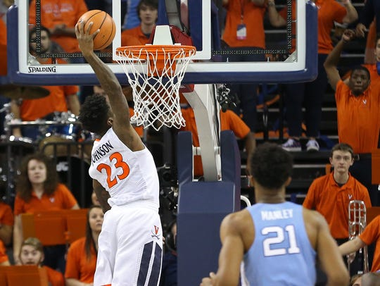 Virginia Cavaliers guard Nigel Johnson (23) dunks the
