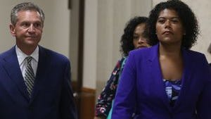 Judge Leticia Astacio and her lawyer, Ed Fiandach, at court.