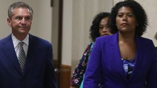 Judge Leticia Astacio and her lawyer, Ed Fiandach,