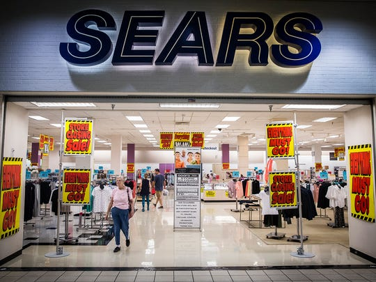 Sears advertises store closing sales at the Muncie