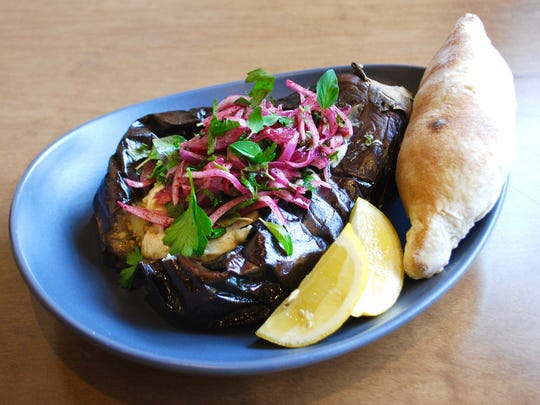 "Baba ganoush ""in its skin"" with lemon and Kurdish samoon bread at Lyra Middle Eastern restaurant."