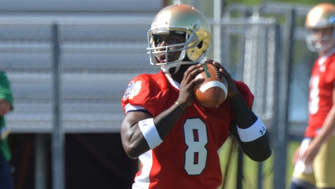 Notre Dame quarterback Malik Zaire throws a pass during practice at an NCAA football training camp Friday, Aug. 7, 2015, in Culver, Ind. (AP Photo/Joe Raymond)
