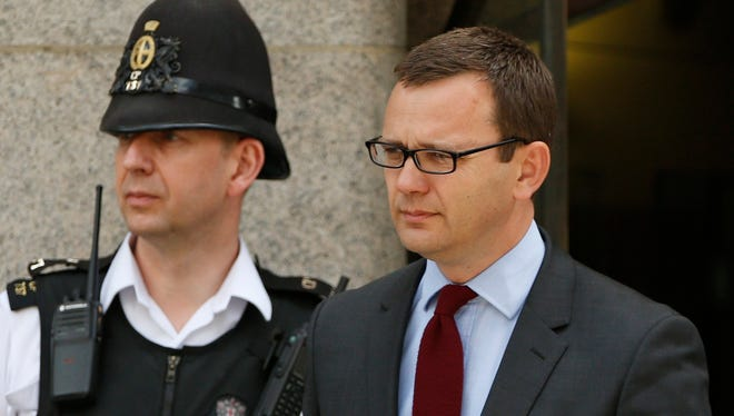 Andy Coulson, former 'News of the World' editor, leaves Central Criminal Court in London on June 25.