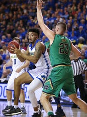 Delaware's Eric Carter tries to work past Notre Dame's Martinis Geben in the first half at the Bob Carpenter Center Saturday.