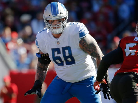 Detroit Lions offensive tackle Taylor Decker blocks