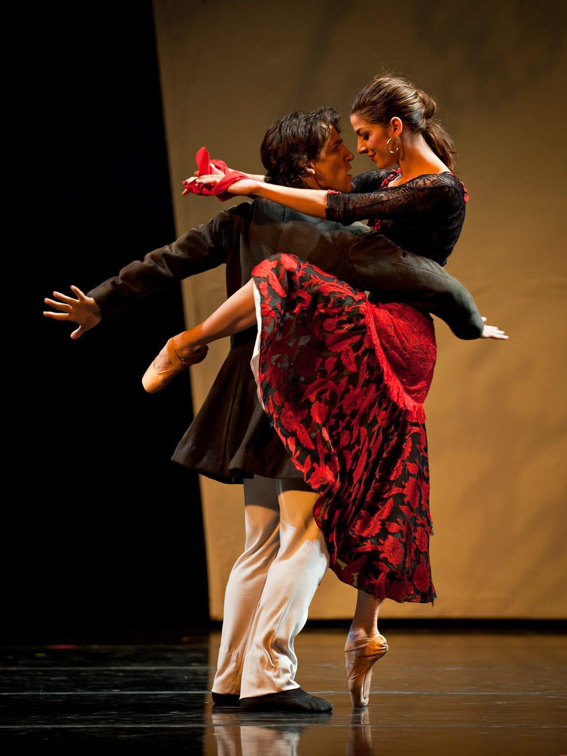 Carmen Diaz and Cervilio Miguel Amador perform in the