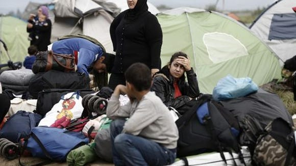 Members of a refugee family sit in front of their tent waiting to be transferred to accommodation centers during a police operation at a refugee camp near the village of Idomeni, Greece on May 24, 2016. Yannis Kolesidis, European Pressphoto Agency