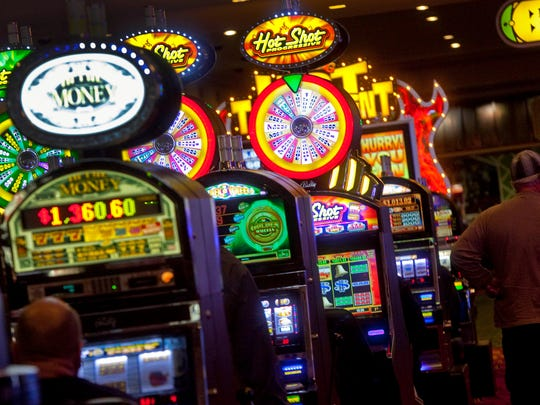 Gamblers are seen playing the slots at Dover Downs Hotel and Casino.