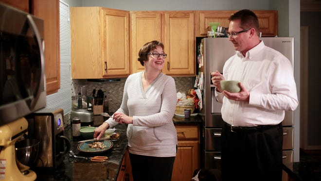 Jeff Sikorski, 50, chats with his wife Laurene Sikorski, 56, in the kitchen of their home in Plymouth, MI on Tuesday, March 1, 2016.