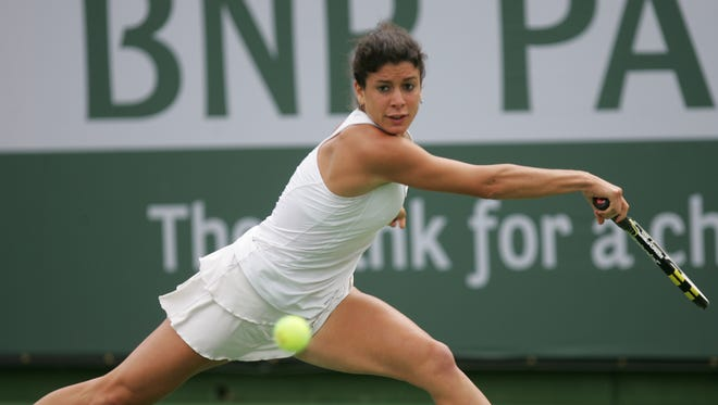 In this file photograph, Julia Cohen reaches for a shot against Eva Birnerova of the Czech Republic on Stadium 2 during the 2012 BNP Paribas Open in Indian Wells.
