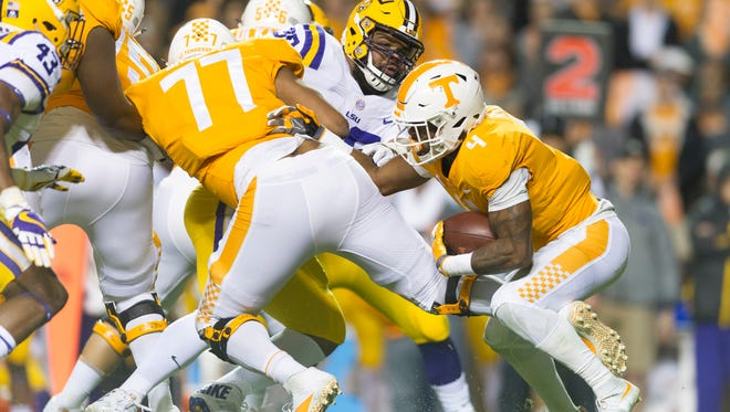 Tennessee running back John Kelly (4) looks for a way apst LSU's defense during a game between Tennessee and LSU at Neyland Stadium in Knoxville, Tennessee, on Saturday, Nov. 18, 2017.