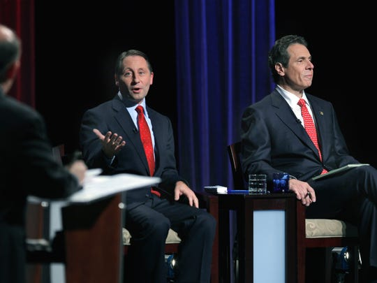 Republican candidate Rob Astorino, left, and Democratic incumbent Andrew Cuomo during Wednesday's gubernatorial debate at the WNED-TV studios in Buffalo. Both major-party candidates went after each other in the lone debate of the campaign.