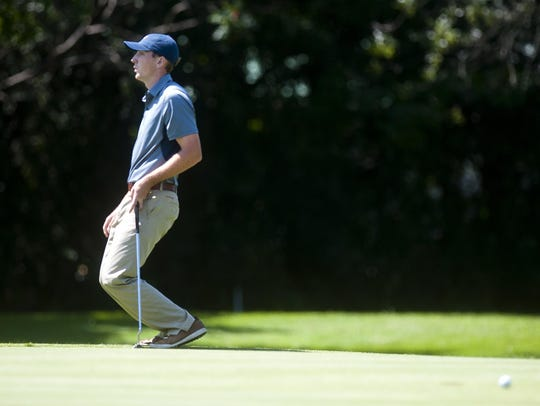 Evan Russell reacts as his eagle putt slips by the