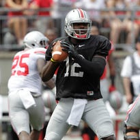 Ohio State quarterback Cardale Jones drops back to pass during Ohio State's NCAA college football spring game Saturday, April 18, 2015, in Columbus, Ohio.