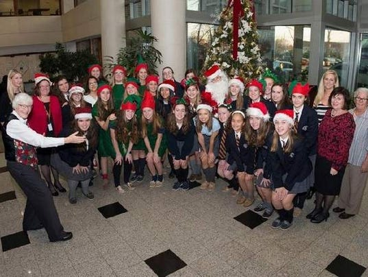Home Group Trinity Foyer : Trinity hall students spread cheer at the unterberg