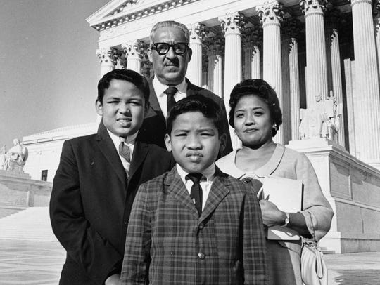 Justice Thurgood Marshall (back center) poses with