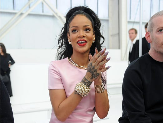 This May 7, 2014, file photo shows singer Rihanna with stiletto nails at the Dior Cruise 2015 Fashion Show at the Brooklyn Navy Yard  in New York. Rhinestones, 3-D designs, textured topcoats and new offerings from fashion royalty have upped the ante on fingertips. Stiletto nails extension, gels or natural nails that are sharpened at the tip.