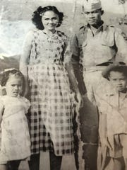 This historic photo shows Filipino WWII veteran Julian Alayon with his wife, Rosalinda, and children Linda (left) and Eduardo.