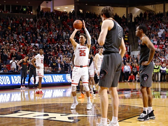 Texas Tech's Davide Moretti (25) shoots a free throw during overtime of the team's NCAA college basketball game against Oklahoma State, Wednesday, Feb. 27, 2019, in Lubbock, Texas. (AP Photo/Brad Tollefson)