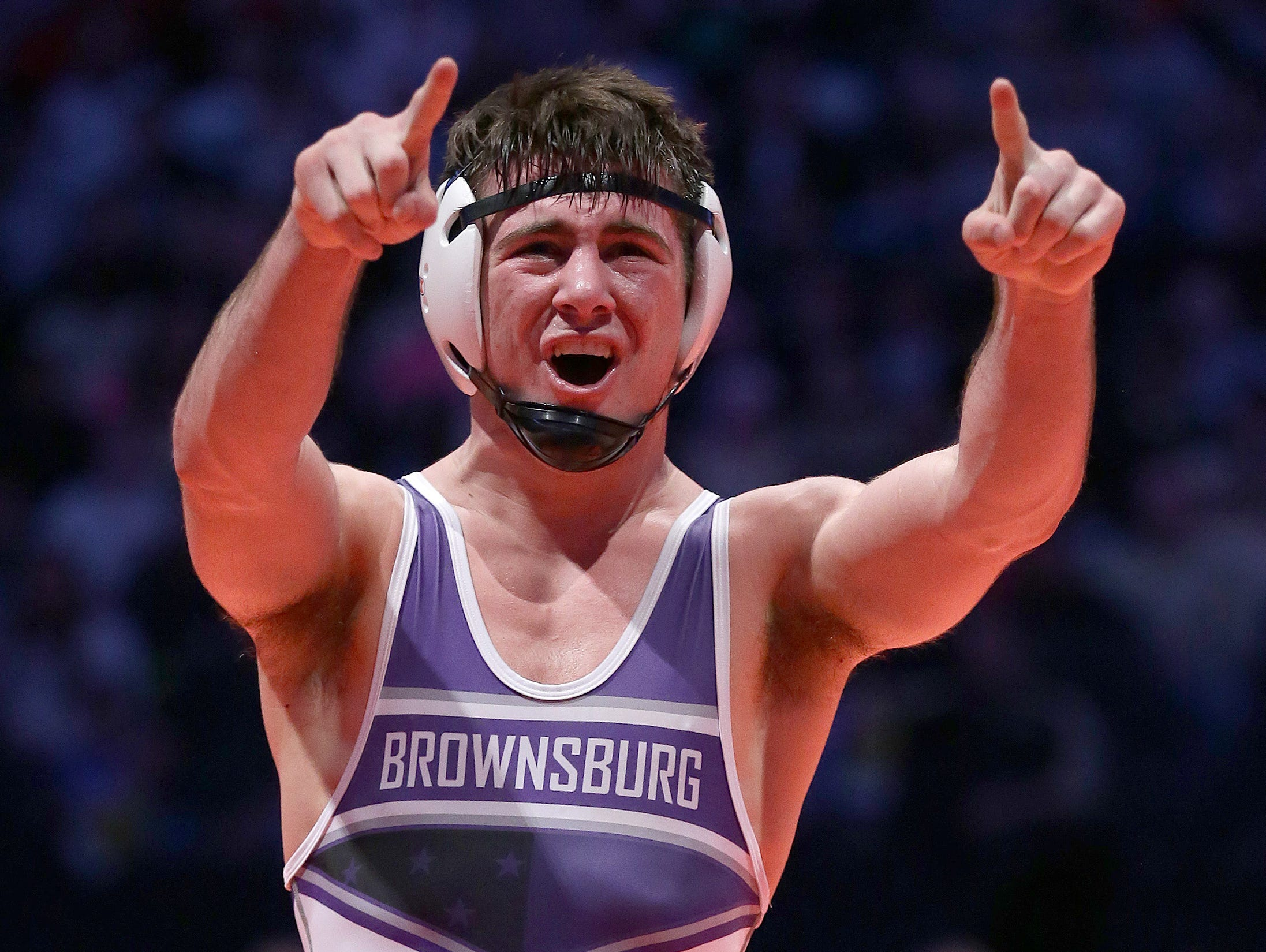 Brownburg's Brayton Lee celebrate his win over Munster's Jason Crary in the 145-pound championship match at the IHSAA Wrestling State Finals Saturday, February 18, 2017, evening at Bankers Life Fieldhouse.