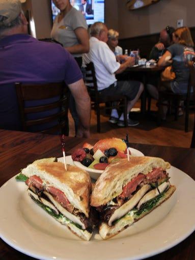 A portobello mushroom veggie sandwich is served with